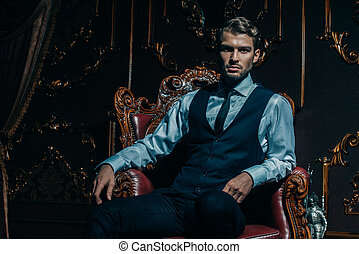well dressed young man imposing well dressed man in a luxurious apartments with classic interior stock photos csp57385933