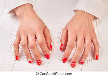 Well-groomed female hands with manicure. Gentle woman hands...