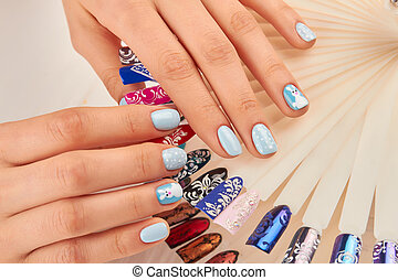 Well-groomed hands with beautiful manicure. Young woman...
