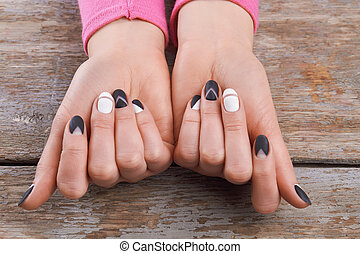 Well-groomed hands with cute manicure. Beautiful woman hands...