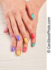 Well-groomed hands with summer manicure. Young woman nails...