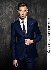 well-groomed handsome man - Fashion shot of a handsome young...