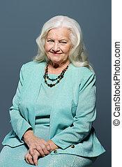 well-groomed senior woman - Portrait of a modern senior...