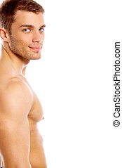 Well Shaped - Muscular and tanned male isolated on white