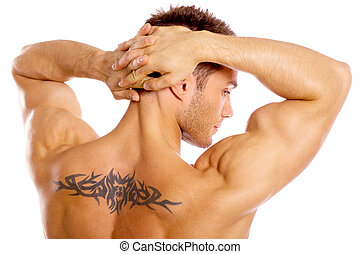 Well Shaped - Muscular and tanned male with tatoo isolated...