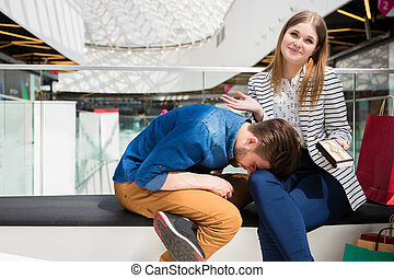 Well, what can I do? - A photo of young couple sitting on...