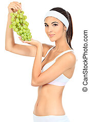 wellbeing - Portrait of a beautiful young woman fresh grapes...