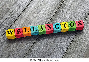 Wellington text on colorful wooden cubes