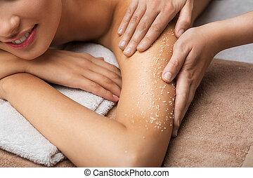 close up of woman having salt massage at spa