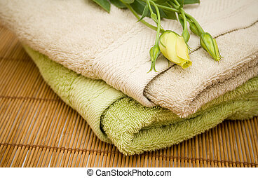Clean terrycloth towels and beautiful yellow flower
