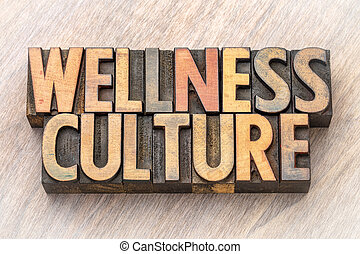 wellness culture - word abstract in wood type