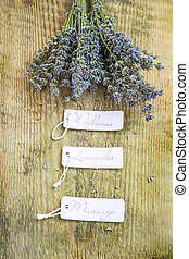 Wellness lavender massage labels with lavender bunch on wooden background
