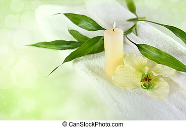 Wellness or spa motiv with bamboo and candles in green