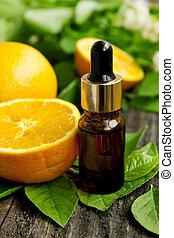 Wellness orange essence - essence bottle with fresh orange...