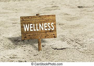 Wellness wooden sign on a beach