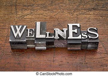 wellness word in metal type