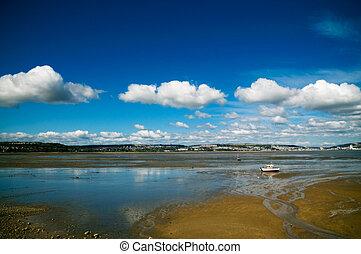 welsh coast lone boat cloudscape