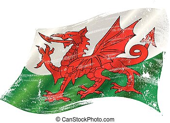 A grunge flag of Wales with the red dragon in the wind for you
