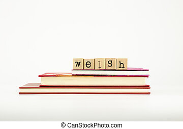 welsh language word on wood stamps and books