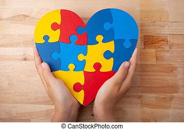 welt, autismus, bewusstsein, tag, geistige gesundheit, sorgfalt, begriff, mit, puzzel, oder, stichsaege, muster, auf, herz, mit, kind, hände