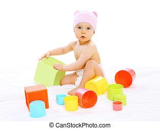 wenig, bunte, Sitzen, Viele, Spielzeuge,  baby, Porträt, Hut, spielende