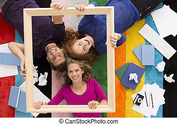 We're so happy together - Top view of a happy three students...