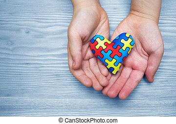 wereld, autisme, bewustzijn, dag, raadsel, of, jigsaw, model, op, hart, met, autisme, kind, handen