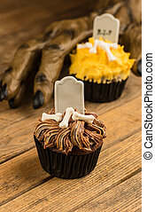 Werewolf hand reaching for cupcake - Chocolate Halloween...