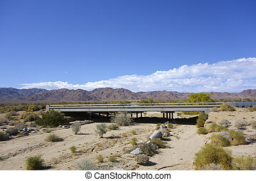 Going West on Christopher Columbus transcontinental highway in Chiriaco mountain desert, CA