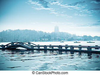 the west lake at dusk in hangzhou, China.