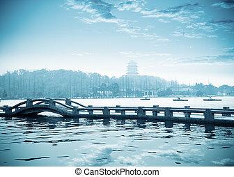 west lake of hangzhou at dusk