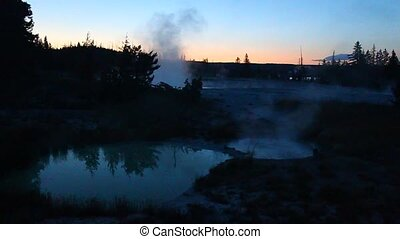 West Thumb Geyser Basin - Yellowsto - Steam rises off hot...