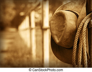 Western cowboy hat and lasso - Western background with...