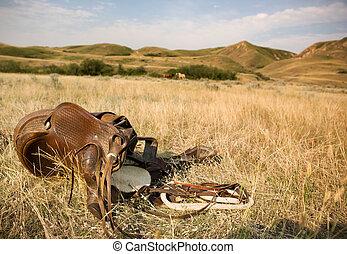 Western Saddle - A western saddle laying on the prairie ...
