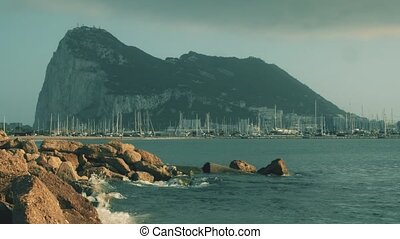 Western side of the Gibraltar Rock and docked sailboats at marina