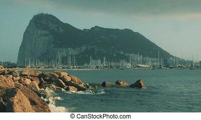 Western side of the Gibraltar Rock and docked sailboats at marina