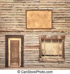 Western vintage wooden facade background. Door, window and blank board