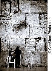 Western Wall in Jerusalem, praying Jews