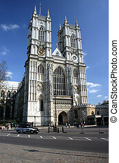 Westminster Abbey building with london black cab car