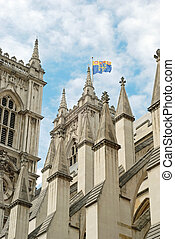 westminster abbey closeup with flag