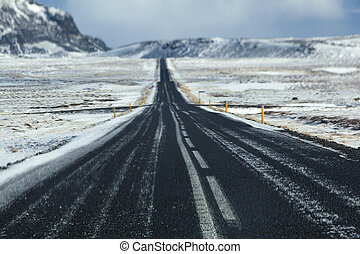 Wet and slippery road in Iceland, wintertime - Wet and...