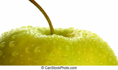 wet apple on white