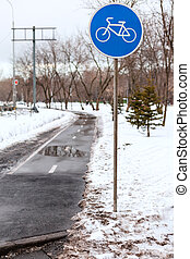 wet bicycle lane in city in bad weather