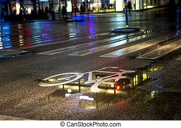 wet bicycle lane - painted symbol in bicycle lane on wet...