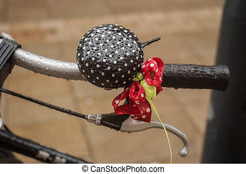 Wet bike bell with a colorful bow