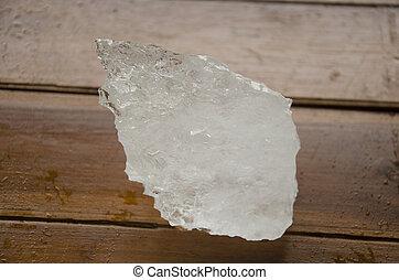 Wet bulk alum on wooden table at outdoor