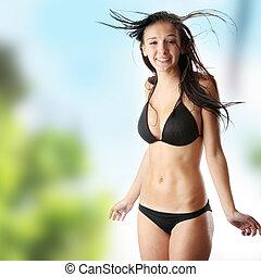Wet caucasian woman in black bikini