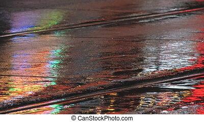 Wet city street at night.