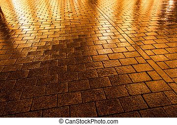 Wet Cobblestone pavement in Berlin, Germany