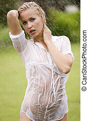 wet dress woman - young sexy blond woman otodoor in a garden...